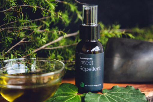 inspect repellent on a table with other natural products around it
