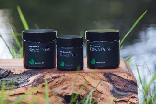 three kawakawa pure products by a log overlooking a river